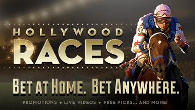 "A jockey on a horse with the logo ""Hollywood Races: Bet at Home. Bet Anywhere."""