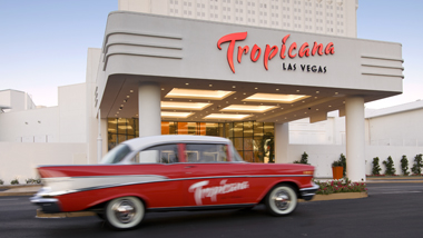 A red and white Chevrolet Bel Air drives past the front valet entrance to the Tropicana Casino Hotel in Las Vegas, Nevada.