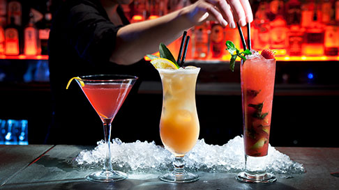 bartender with three different drinks