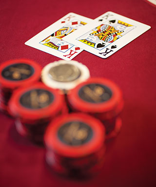 chips and 2 cards on red table 2